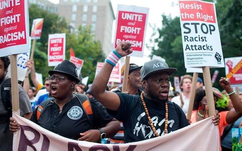 Antifa and counter protestors to a far-right rally march during the Unite the Right 2 Rally in Washington, DC, - Credit: AFP