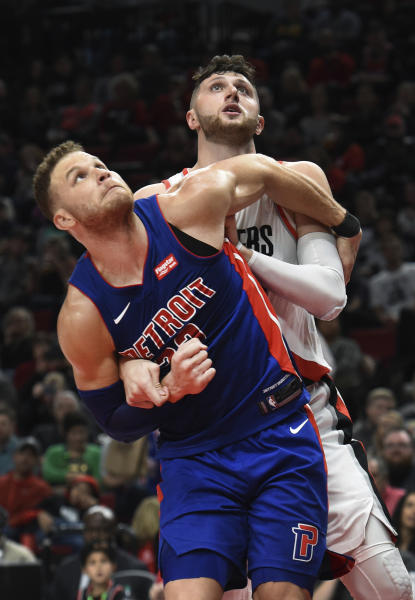Detroit Pistons forward Blake Griffin and Portland Trail Blazers center Jusuf Nurkic work for position under the basket during the second half of an NBA basketball game in Portland, Ore., Saturday, March 17, 2018. The Blazers won 100-87. (AP Photo/Steve Dykes)