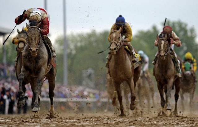 Joel Rosario rides Orb to win the 139th Kentucky Derby at Churchill Downs Saturday, May 4, 2013, in Louisville, Ky. (AP Photo/David J. Phillip)