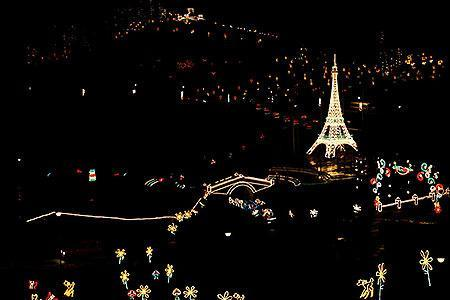 COLOMBIA: A replical of Paris' Eiffel Tower is lit up for Christmas at Puente de Bocaya in Tunja, Colombia December 13, 2007.