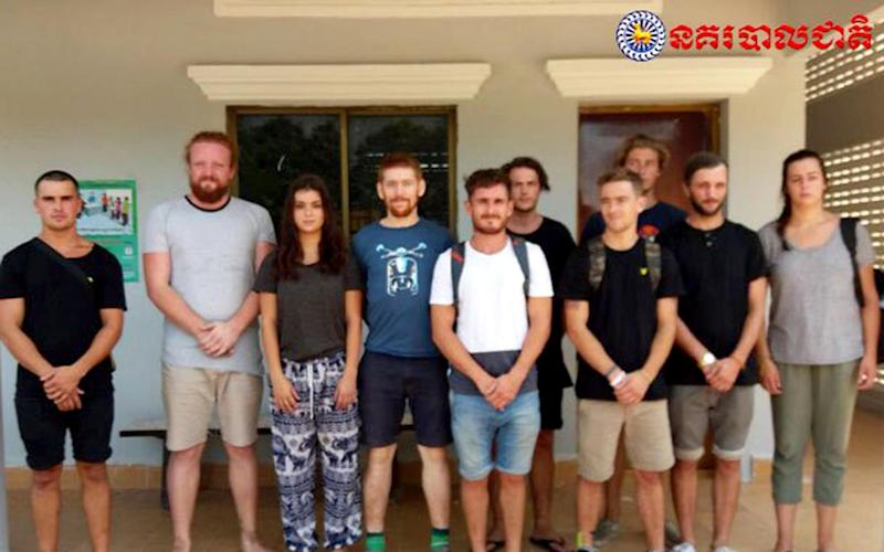 A photograph released by the Cambodian police show the ten foreign tourists who have been detained - PA