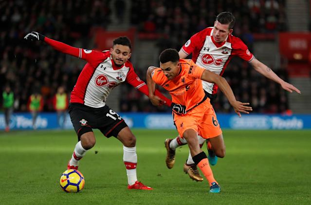 "Soccer Football - Premier League - Southampton vs Liverpool - St Mary's Stadium, Southampton, Britain - February 11, 2018 Liverpool's Trent Alexander-Arnold in action with Southampton's Sofiane Boufal and Pierre-Emile Hojbjerg Action Images via Reuters/Peter Cziborra EDITORIAL USE ONLY. No use with unauthorized audio, video, data, fixture lists, club/league logos or ""live"" services. Online in-match use limited to 75 images, no video emulation. No use in betting, games or single club/league/player publications. Please contact your account representative for further details."