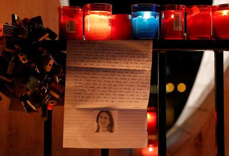 A letter to investigative journalist Daphne Caruana Galizia, assassinated in a car bomb attack on Monday, is seen on the Love monument during a silent candlelight vigil to protest against her murder, in St Julian's, Malta, October 16, 2017.  REUTERS/Darrin Zammit Lupi