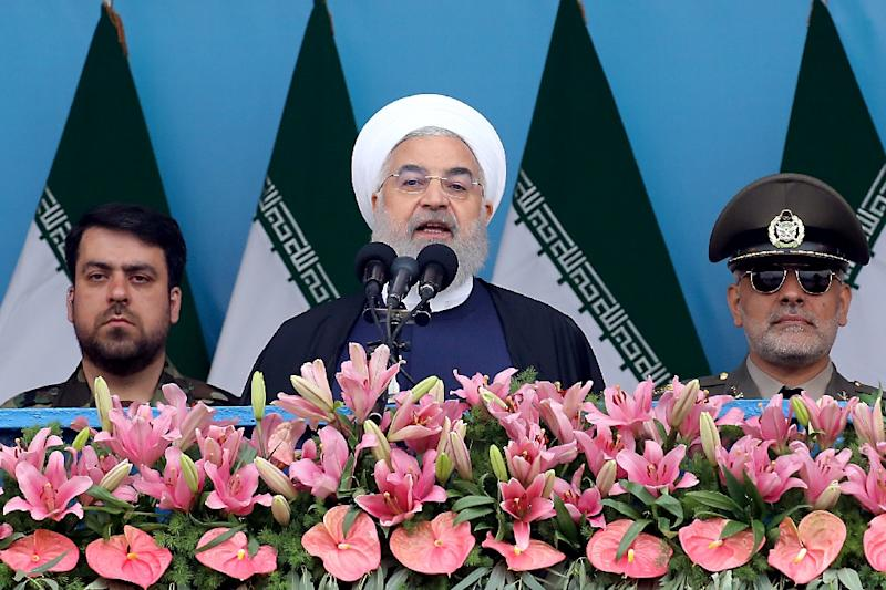 Iranian President Hassan Rouhani, seen here in April 2019 addressing a military ceremony, will reportedly announce retaliatory measures against the United States for withdrawing from a multinational nuclear deal (AFP Photo/-)