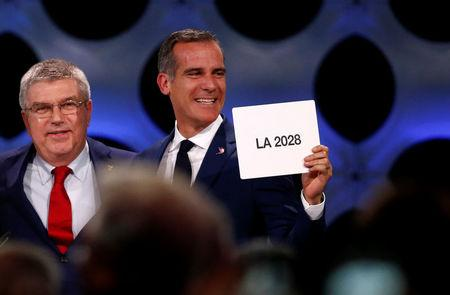 International Olympic Committee (IOC) President Thomas Bach next Mayor of Los Angeles Eric Garcetti ratifies Paris 2024 and Los Angeles 2028 host cities for Olympics games during the 131st IOC session in Lima, Peru September 13, 2017. REUTERS/Mariana Bazo
