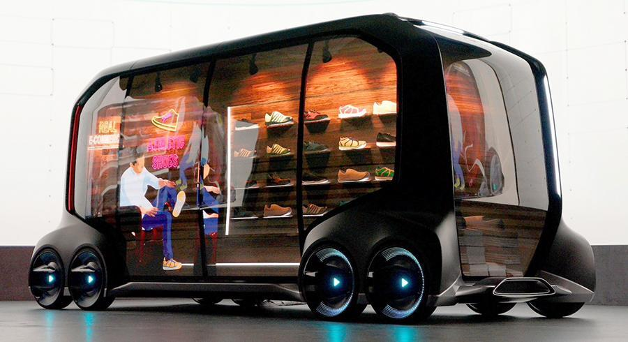 Toyota envisions its E-Palette as a self-driving store, delivery van, or even hotel room.