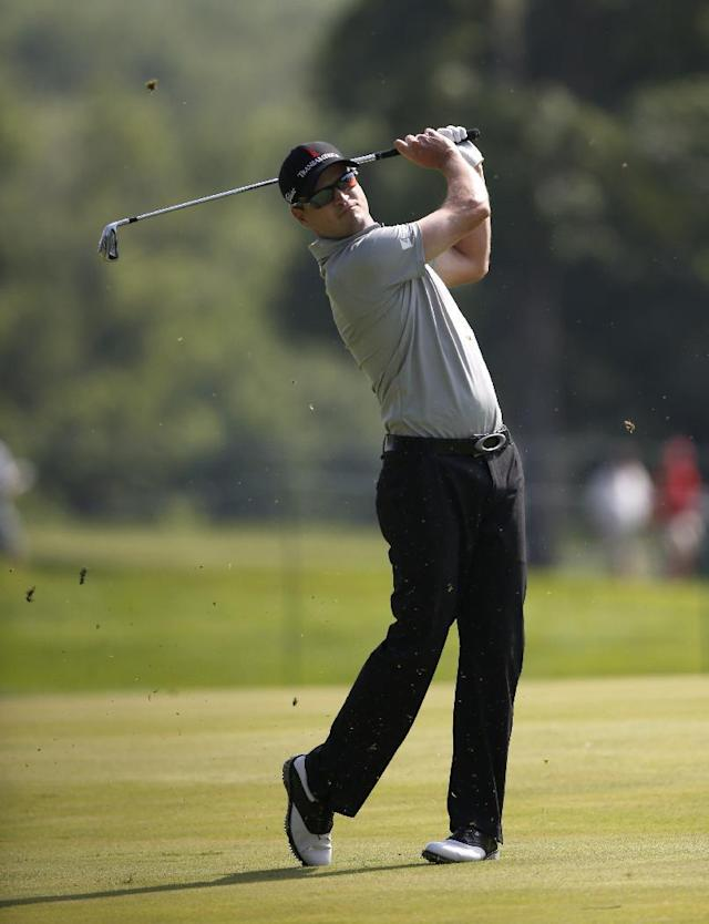Zach Johnson watches his approach attempt on the 18th fairway during the first round of the 2014 John Deere Classic golf tournament at TPC Deere Run in Silvis, Ill., Thursday, July 10 2014. (AP Photo/Charles Rex Arbogast)
