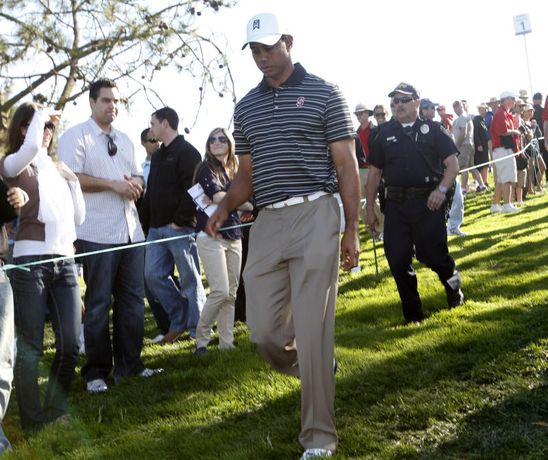 Tiger Woods walks through the gallery at Torrey Pines during the third round of the Farmers Insurance Open golf tournament in  San Diego, Saturday, Jan. 29, 2011. (AP Photo/Lenny Ignelzi)
