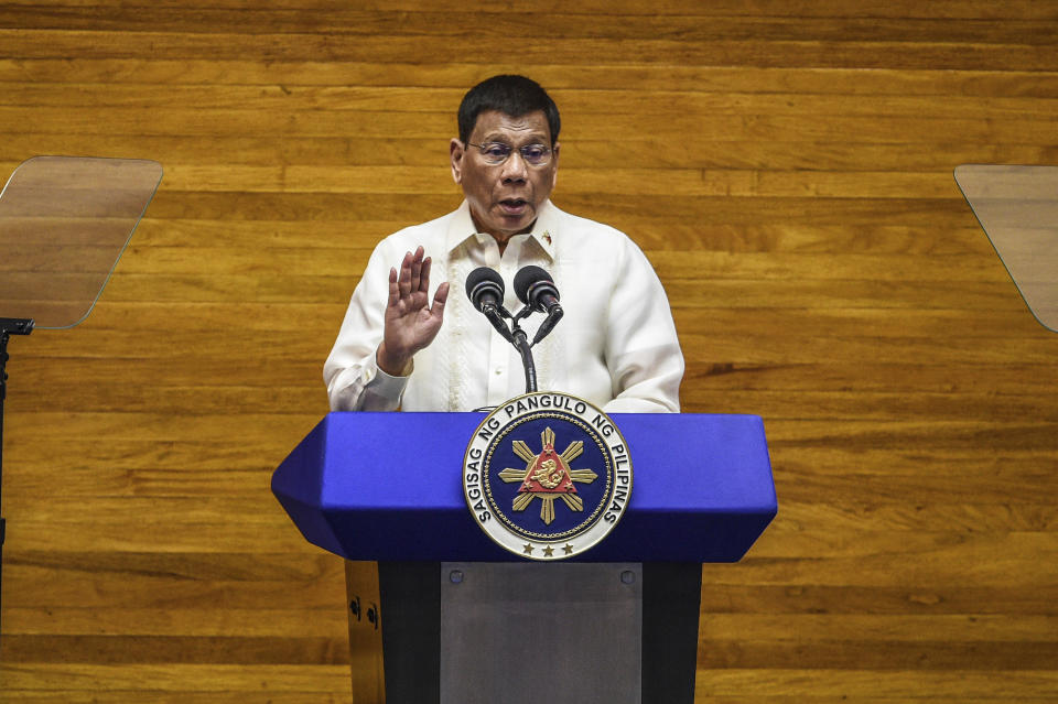 Philippine President Rodrigo Duterte gestures as he delivers his final State of the Nation Address at the House of Representatives in Quezon City, Philippines on Monday, July 26, 2021. Duterte delivered his final State of the Nation speech Monday before Congress, winding down his six-year term amid a raging pandemic, a battered economy and a legacy overshadowed by a bloody anti-drug crackdown that set off complaints of mass murder before the International Criminal Court. (Jam Sta Rosa/Pool Photo via AP)