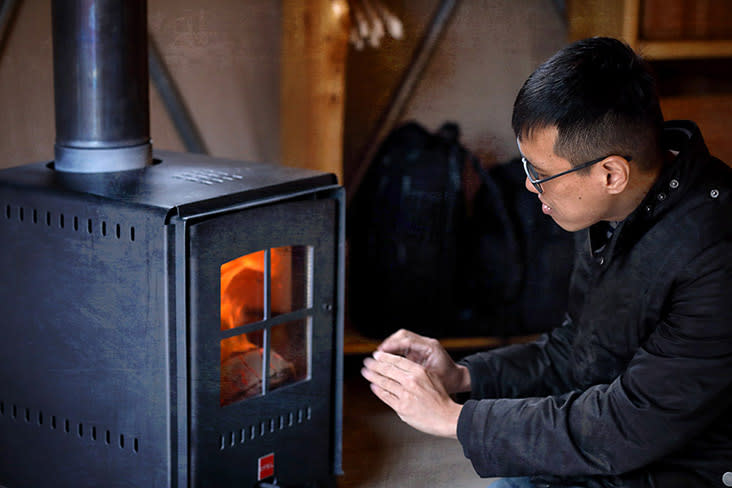 Light a fire with a low-emission wood stove.
