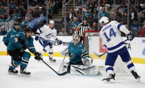 San Jose Sharks goaltender Aaron Dell (30) watches the puck after making a save against Tampa Bay Lightning left wing Pat Maroon (14) during the second period of an NHL hockey game in San Jose, Calif., Saturday, Feb. 1, 2020. At left is Sharks defenseman Radim Simek. (AP Photo/Josie Lepe)