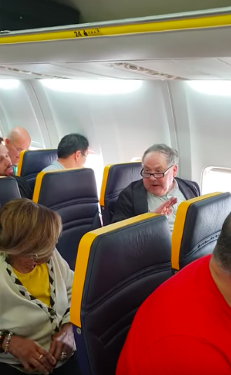 In the video, the white man berates the elderly black woman sitting one seat away from him. (David Lawrence/Facebook)