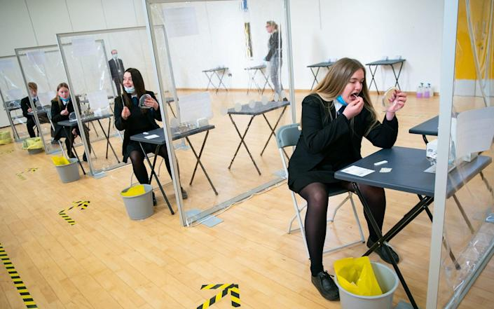 Pupils are tested on arrival at a school in Coulsdon, Surrey, earlier this month - Aaron Chown/PA