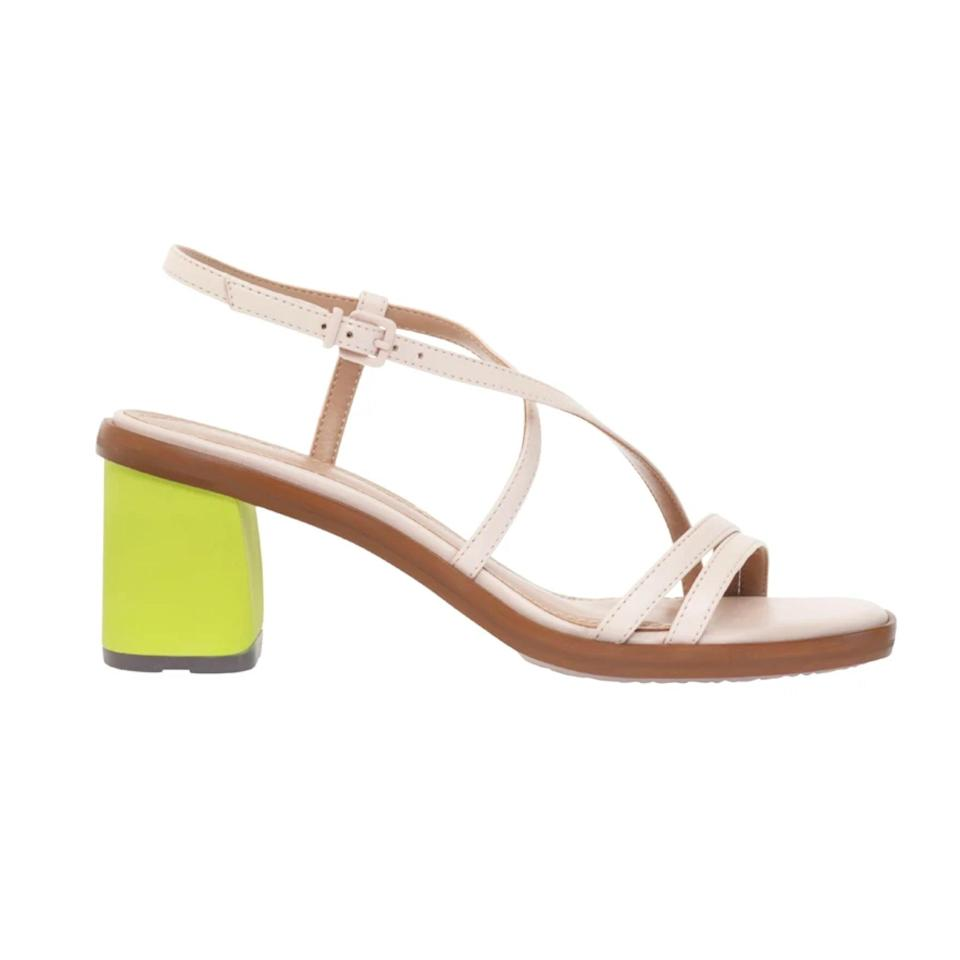 """This new footwear brand was dreamed up last year when its founder was recovering from COVID—genius. This riff on sling-back pumps is versatile enough to wear to a wedding or to work, and the lime-green heel provides a perfect pop of color. $294, Della Terra. <a href=""""https://dellaterrashoes.com/collections/all/products/cassia-1"""" rel=""""nofollow noopener"""" target=""""_blank"""" data-ylk=""""slk:Get it now!"""" class=""""link rapid-noclick-resp"""">Get it now!</a>"""
