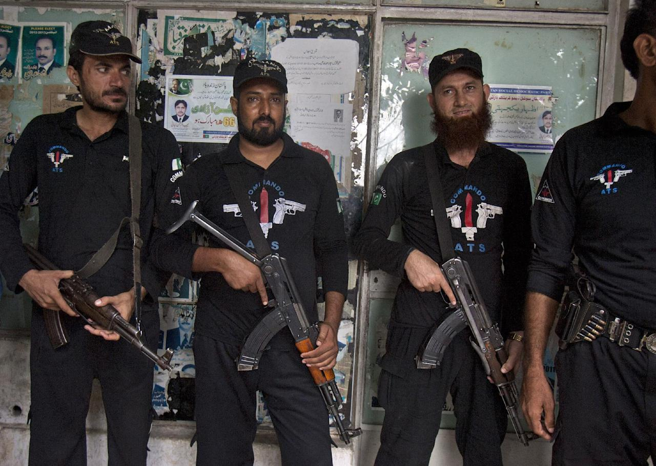 Pakistani police commandos stand guard at outside a court, where Muslim cleric Khalid Chishti, unseen, appeared in Islamabad, Pakistan on Sunday, Sept. 2, 2012. In the latest twist in a religiously charged case that has focused attention on the country's harsh blasphemy laws, Pakistani police arrested Chishti who they say planted evidence in the case of a Christian girl accused of blasphemy. (AP Photo/Anjum Naveed)