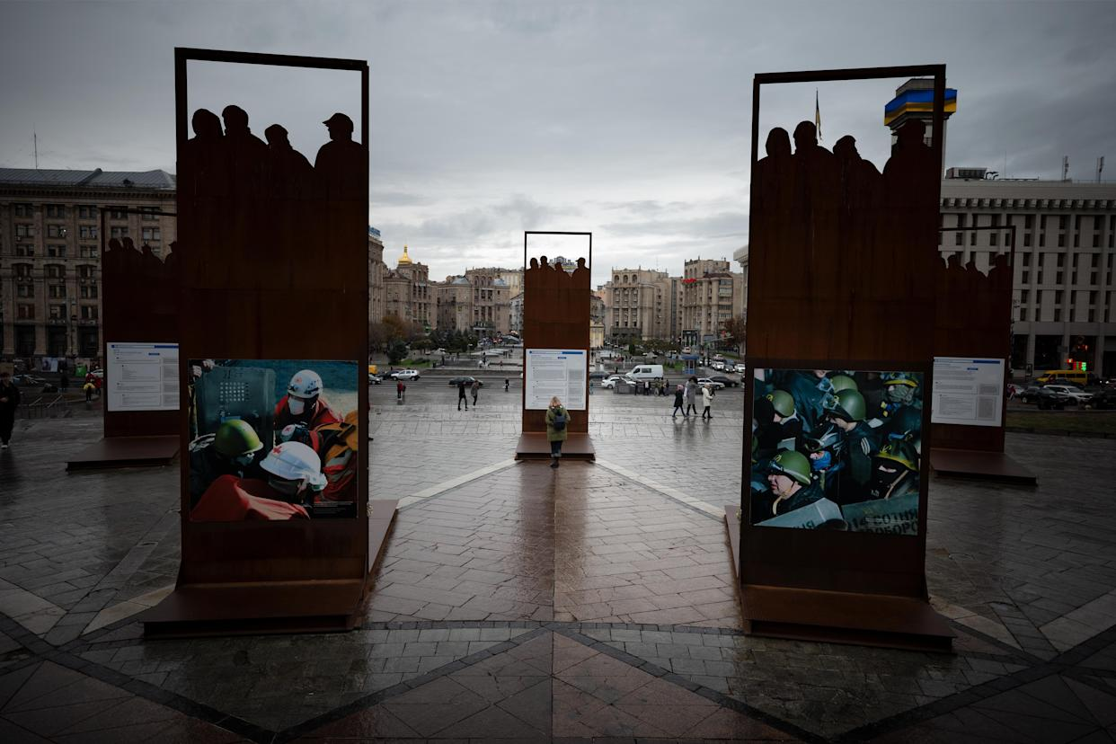 Tourists visit the memorial of the Maidan Square revolution in Kiev. (Photo: Agron Dragaj for Yahoo News)