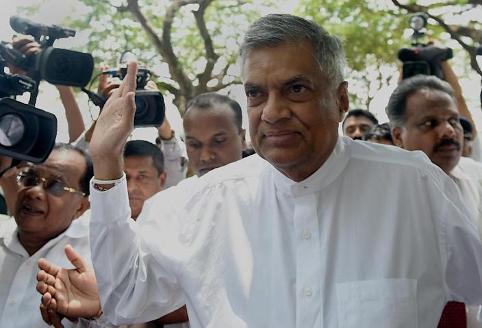 """Sri Lanka's Prime Minister Ranil Wickremesinghe told reporters that he was confident of forming a new government that could """"consolidate the January 8 revolution"""" (AFP Photo/Ishara S.Kodikara)"""