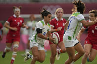 Brazil's Isadora Cerullo runs with the ball in Brazil's women's rugby sevens 9-12 placing match against Canada at the 2020 Summer Olympics, Friday, July 30, 2021 in Tokyo, Japan. (AP Photo/Shuji Kajiyama)