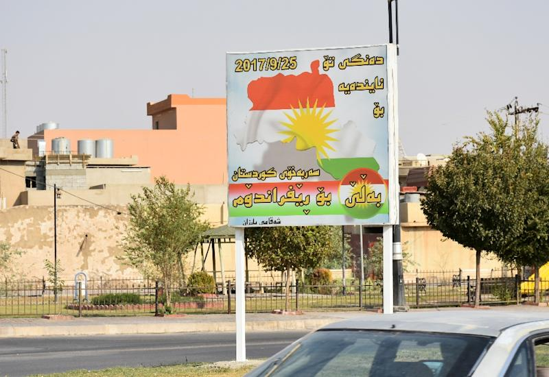A billboard calls for voters in the city of Kirkuk to take part in a controversial September 25 independence referendum for Iraqi Kurdistan (AFP Photo/Marwan IBRAHIM)
