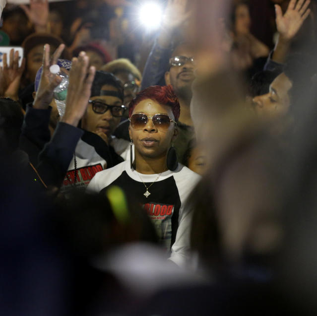 <p>Lezley McSpadden, mother of Michael Brown looks at law enforcement officers as she attends a protest at the Ferguson Police Department Saturday, Oct. 11, 2014, in Ferguson, Mo. (AP Photo/Charles Rex Arbogast) </p>