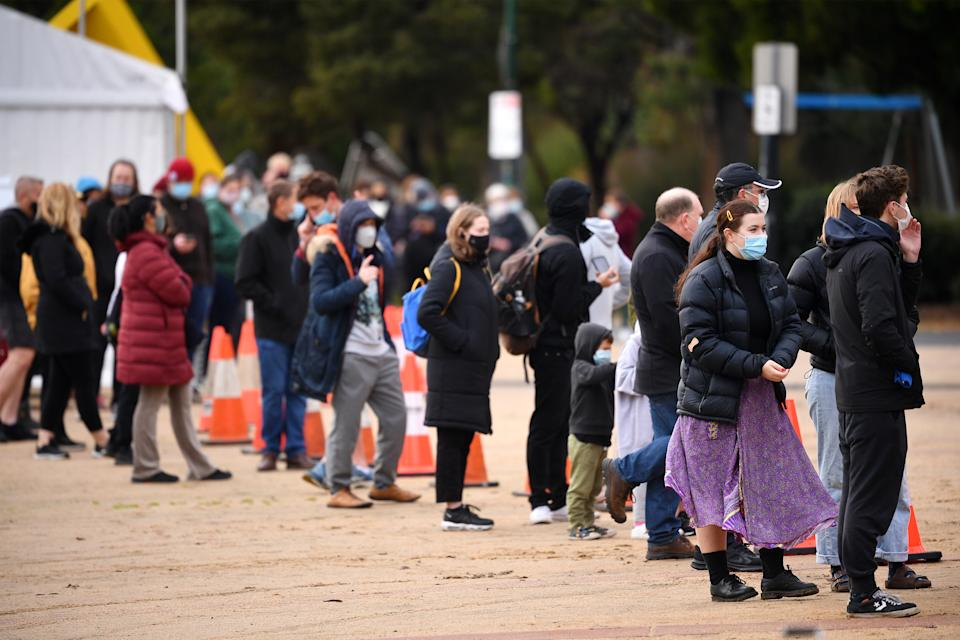 People are seen waiting in line at a pop-up Covid-19 testing facility outside of the Australian Centre for Contemporary Art complex in Melbourne. Source: AAP