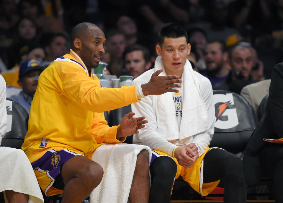 FILE - In this Wednesday, Nov. 26, 2014 file photo, Los Angeles Lakers guard Kobe Bryant, left, talks with guard Jeremy Lin during the first half of an NBA basketball game against the Memphis Grizzlies in Los Angeles. For the G League Ignite, it was a beginning. For Jeremy Lin, it may be a new beginning. He's one of the former NBA players in the G League bubble at Walt Disney World in Lake Buena Vista, Florida this month, as part of the Santa Cruz Warriors. (AP Photo/Mark J. Terrill, File)