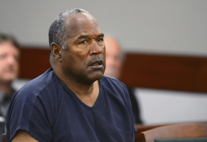 FILE - In this May 14, 2013, file photo, O.J. Simpson appears at an evidentiary hearing in Clark County District Court in Las Vegas.  Simpson's attorney says the former football star has been banned from The Cosmopolitan hotel-casino in Las Vegas. Attorney Malcolm LaVergne on Thursday, Nov. 9, 2017, told The Associated Press that Simpson received a trespass notice from the hotel Wednesday. (Ethan Miller via AP, Pool, File)