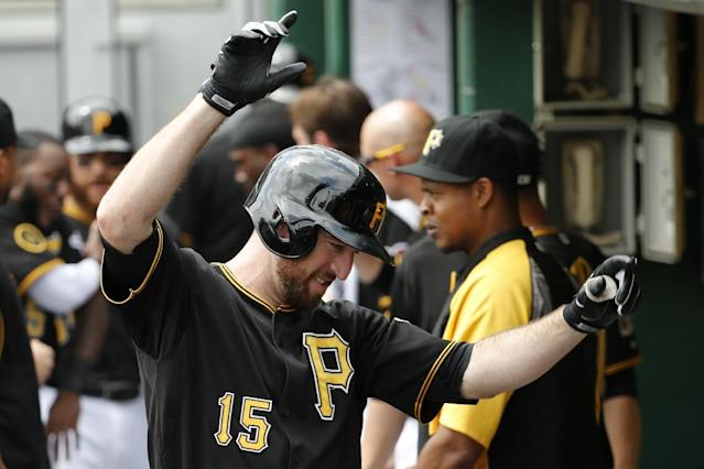 Pittsburgh Pirates' Ike Davis (15) celebrates with teammates in the dugout after hitting a two-run home run off St. Louis Cardinals' starting pitcher Adam Wainwright during the second inning of a baseball game in Pittsburgh Wednesday, Aug. 27, 2014. (AP Photo/Gene J. Puskar)