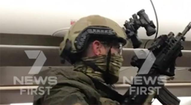 Officials managed to put the man in custody. Photo: 7 News