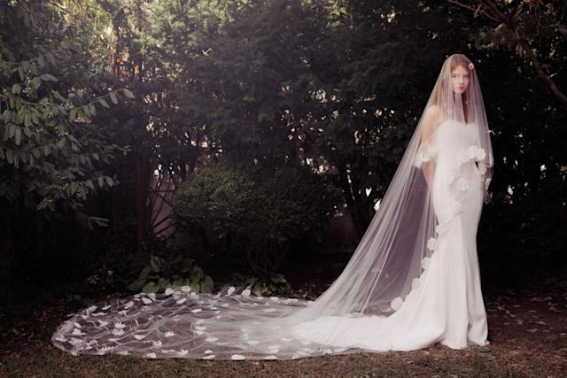 <p>Dress with long veil petal train. (Photo: Honor) </p>