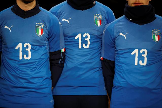 Soccer Football - International Friendly - Italy vs Argentina - Etihad Stadium, Manchester, Britain - March 23, 2018 Italy players wearing shirts in memory of Davide Astori Action Images via Reuters/Carl Recine