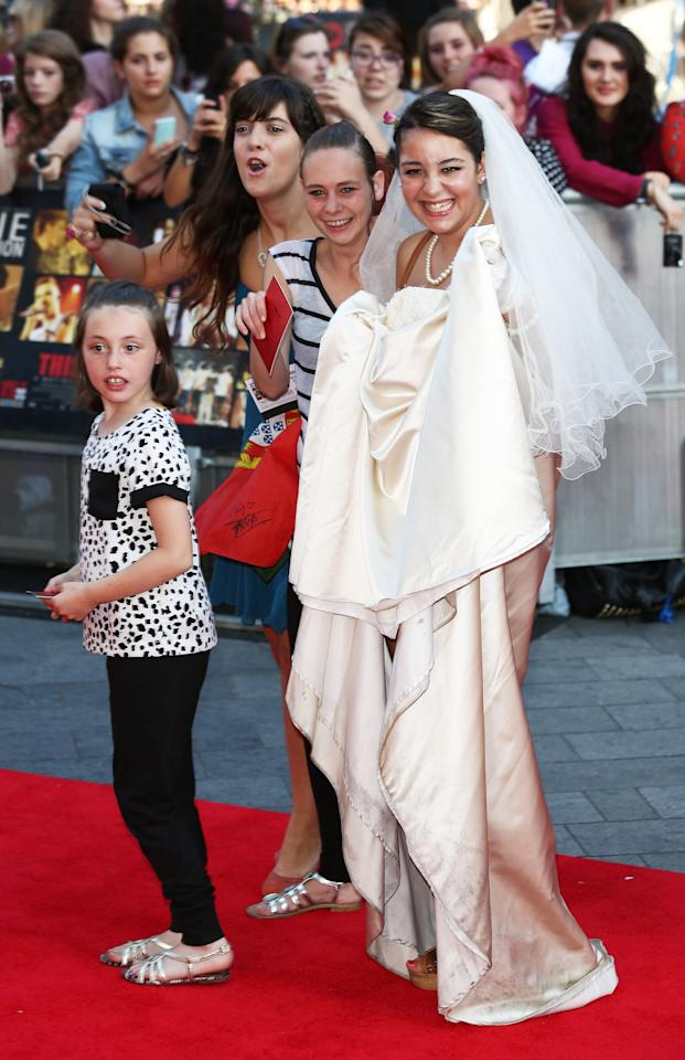 LONDON, ENGLAND - AUGUST 20: A fan wearing a wedding dress attends the World Premiere of 'One Direction: This Is Us' at Empire Leicester Square on August 20, 2013 in London, England. (Photo by Tim P. Whitby/Getty Images)
