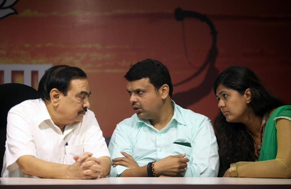 Eknath Khadse (Left), who left the BJP to join NCP, withDevendra Fadnavis and Pankaja Munde in a file photo. Pankaja is also reported to be unhappy with Fadnavis. (Photo: Hindustan Times via Getty Images)