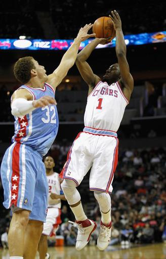CHARLOTTE, NC - FEBRUARY 11: Kemba Walker #1 of the Charlotte Bobcats shoots the ball over Blake Griffin #32 of the Los Angeles Clippers during their game at Time Warner Cable Arena on February 11, 2012 in Charlotte, North Carolina. (Photo by Streeter Lecka/Getty Images)