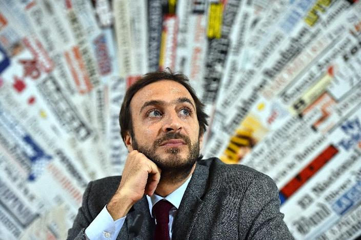 Emiliano Fittipaldi, an Italian journalist facing a criminal probe over the Vatileaks scandal, says he is stunned he has been charged, saying those he exposed should be the subjects of investigations (AFP Photo/Gabriel Bouys)