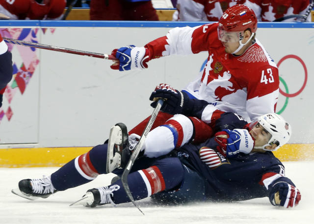 Russia forward Valeri Nichushkin collides with USA forward Max Pacioretty in the second period of a men's ice hockey game at the 2014 Winter Olympics, Saturday, Feb. 15, 2014, in Sochi, Russia. (AP Photo/Julio Cortez)