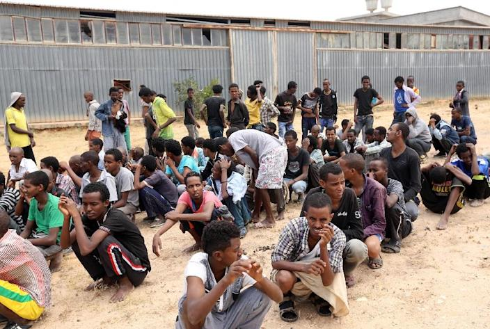 Migrants from sub-Saharan Africa rest inside a detention center in the Libyan capital, Tripoli, on June 9, 2015, after authorities, acting on a tip off, stormed a hideout where more than 760 illegal migrants were waiting to embark a vessel (AFP Photo/Mahmud Turkia)