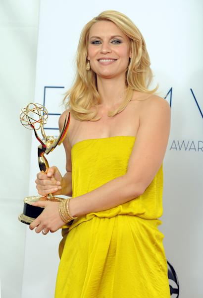 """Actress Claire Danes, winner of the award Outstanding Lead Actress In A Drama Series award for """"Homeland,"""" poses backstage at the 64th Primetime Emmy Awards at the Nokia Theatre on Sunday, Sept. 23, 2012, in Los Angeles. (Photo by Jordan Strauss/Invision/AP)"""