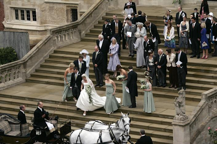 Members of Britains royal family and guests leave St George's Chapel in Windsor on May 17, 2008 after the marriage vows of Peter Phillips 30 (4th L), and Canadian Autumn Kelly 31 (5th L). The bride recently converted from Roman Catholicism to Anglicanism so that her husband, son of the Princess Royal, Princess Anne, will not have to renounce his right of royal succession. AFP PHOTO / POOL / Sang Tan (Photo credit should read SANG TAN/AFP via Getty Images)