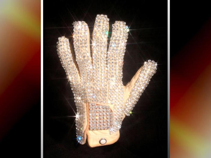 Michael Jackson's glove from his 1983 performance of Billie Jean at the Motown 25 television special where he performed the Moonwalk for the first time, Julien's Auctions handount image on texture, partial graphic