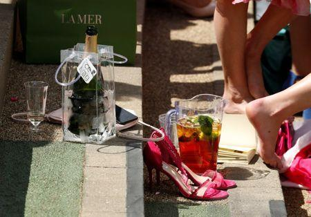 Horse Racing - Royal Ascot - Ascot Racecourse, Ascot, Britain - June 21, 2018 General view of a racegoers' shoes and drinks in the stands Action Images via Reuters/Andrew Boyers