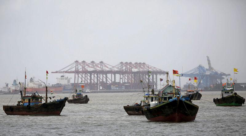 Fishing trawlers are seen in front of JNPT in Mumbai