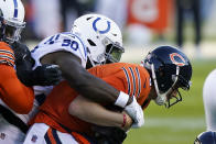 Chicago Bears quarterback Nick Foles is sacked by Indianapolis Colts' Justin Houston (50) during the second half of an NFL football game Sunday, Oct. 4, 2020, in Chicago. (AP Photo/Nam Y. Huh)