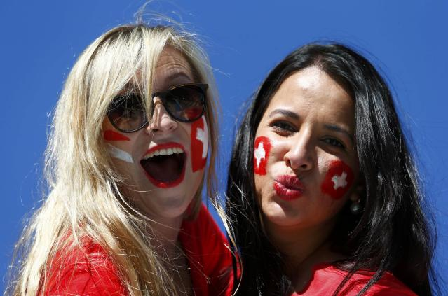 Switzerland fans pose before the 2014 World Cup round of 16 game between Argentina and Switzerland at the Corinthians arena in Sao Paulo July 1, 2014. REUTERS/Eddie Keogh (BRAZIL - Tags: SOCCER SPORT WORLD CUP)