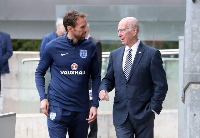 England manager Gareth Southgate (left) and Sir Bobby Charlton during a training session