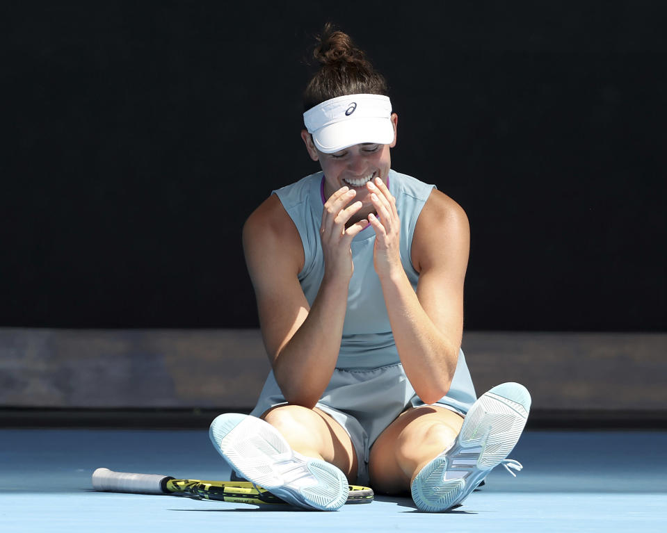 United States' Jennifer Brady sits on the court after playing a point against Slovenia's Kaja Juvan during their match at the Australian Open tennis championships in Melbourne, Australia, Saturday, Feb. 13, 2021. (AP Photo/Hamish Blair)