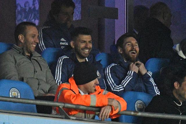 Sidelined: Lionel Messi sits with Sergio Aguero as Argentina beat Italy 2-0 in Manchester (AFP Photo/Oli SCARFF)
