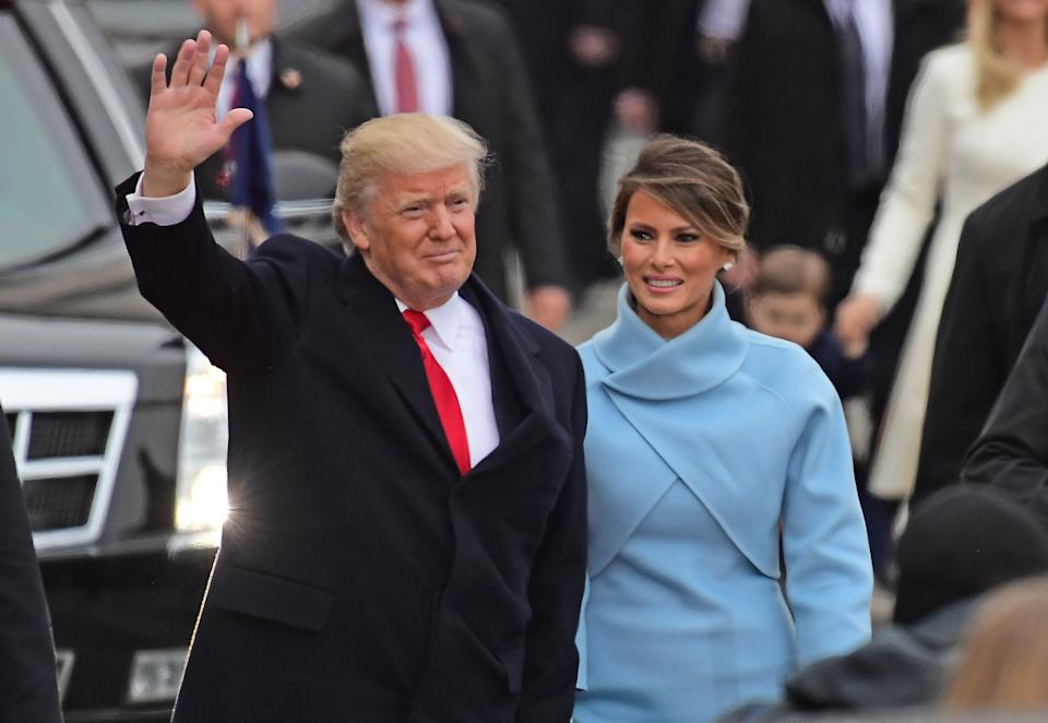 United States President Donald J. Trump and first lady Melania Trump walk in the Inaugural Parade celebrating the Inauguration of Donald J. Trump as the 45th President of the United States down Pennsylvania Avenue in Washington, DC on Friday, January 20, 2017. (Photo by Ron Sachs/CNP) (Restrictions: No New York or New Jersey Newspapers or newspapers within a 75 mile radius of New York City) *** Please Use Credit from Credit Field ***