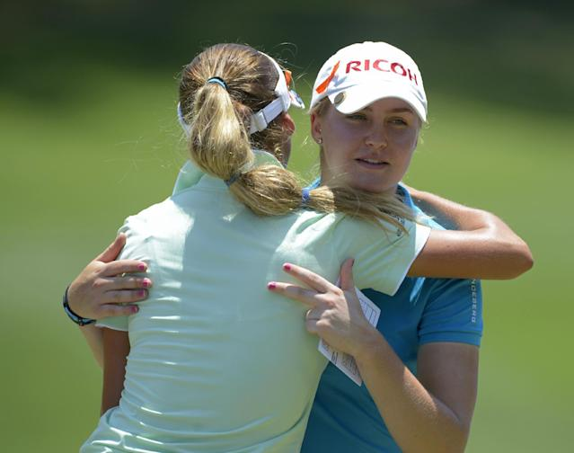 Charley Hull of England, facing camera, hugs Belen Mozo of Spain after their group completes play on the ninth hole during the second round of the Airbus LPGA Classic golf tournament at Magnolia Grove on Friday, May 23, 2014, in Mobile, Ala. (AP Photo/G.M. Andrews)