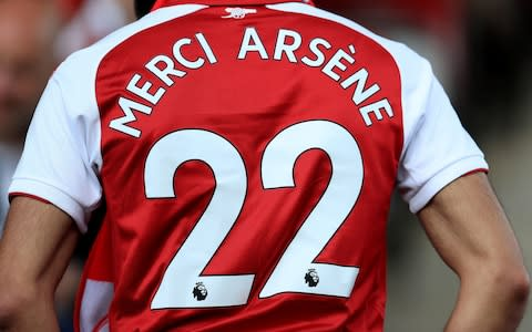 """To the end, there was dignity and, to use one of his favourite words, , humanity to Arsene Wenger as he bowed out,quite literally, as Arsenal manager after 22 years, 1,235 games and this, his 707th victory. One-nil to the Arsenal, in fact, although that was never a scoreline he cherished or that was associated with him. There was sentimentality, too – and why not as Wenger spoke of the appropriateness of Huddersfield Town being his final opponent in what otherwise was an inconsequential fixture? """"Herbert Chapman, maybe our greatest manager, came from here,"""" Wenger said. """"For me to come here on the last day had a special meaning when you know the history of our club. In fact, there was a photo just in front of the dressing room where Chapman smiled at me because he was on the photo."""" Chapman smiling down on Wenger is certainly some romantic image, one that resonates powerfully for all Arsenal fans. Chapman was Huddersfield's greatest manager, in their golden period in the 1920s when they won league titles, with three stars adorning their shirts, and were such a force in English football that he was poached by Arsenal and transformed them too. For 22 years, for 1,235 games, for 49, 49 undefeated, for 7 FA Cups, for 3 @PremierLeague titles, for two Doubles, for winning the league at Old Trafford and White Hart Lane, for Wengerball, for the Invincibles, for your total love and devotion, we want to say... #MerciArsène❤️ pic.twitter.com/xkRXjLAid2— Arsenal FC (@Arsenal) May 13, 2018 Chapman revolutionised the role of the manager, making him more powerful in an era when decisions were made by committee. Privately, Wenger might ruefully consider the wheel is turning full circle away from his profession, given the nature of his departure, as he first walked past the bust of Chapman at the entrance to the John Smith Stadium, then the photograph before he took to the pitch to be met by a guard of honour. Before kick-off, Wenger strode towards the travelling Arsenal supporters """